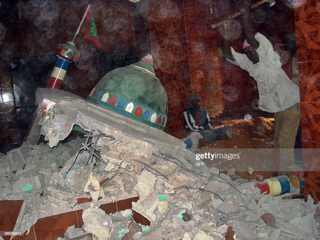 Islamist fighters allied to Alshabab destroy the grave of Sheik Biyo Mal a wellknown Somali cleric buried in Holwadag district of the Somalia capital...
