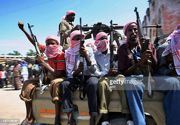 Islamist militants loyal to newly elected President Shaikh Sharif Sheikh Ahmed patrol through Mogadishu on February 19 2009 Islamic fighters allied...
