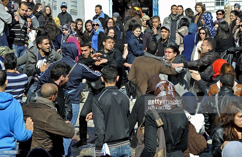 Islamist students attack students of the Bourguiba Language Institute in the El Khadra neighbourhood, a Salafist bastion, of the capital Tunis, as they try to prevent the filming of current Internet craze the 'Harlem Shake' on February 27, 2013. Salafist Muslims caused a fight when they tried to prevent the filming of the global online buzz, but the Islamists eventually withdrew and the students were able to film their production.