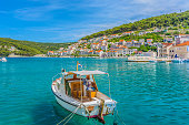 Waterfront view at small picturesque town Pucisca, Island of Brac, Croatia summertime.