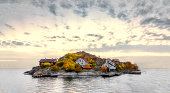 Island in swedish archipelago under sunset light and with autumn colors