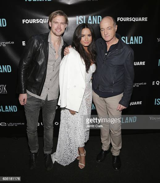 Island Records artists Chord Overstreet and Demi Lovato pose with David Massey President of Island Records attend Island Records PreGrammy Party...
