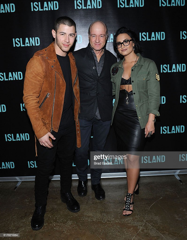Island Records Recording Artist Nick Jonas, President - CEO of Island Records David Massey and Island Records Recording Artist Demi Lovato attend Island Records' 'Island Life' Second Anniversary Party At Avenue NYC at Avenue on March 22, 2016 in New York City.