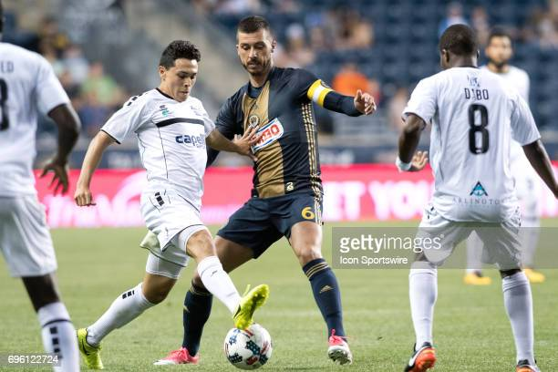 Islanders Forward James Thomas keeps the ball from Union Midfielder Haris Medunjanin in the second half during the US Open Cup Game between the...