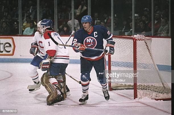 Islanders forward Mike Bossy wearing the captain's C stands in the crease behind Canadiens goaltender Brian Hayward in a game at the Montreal Forum...