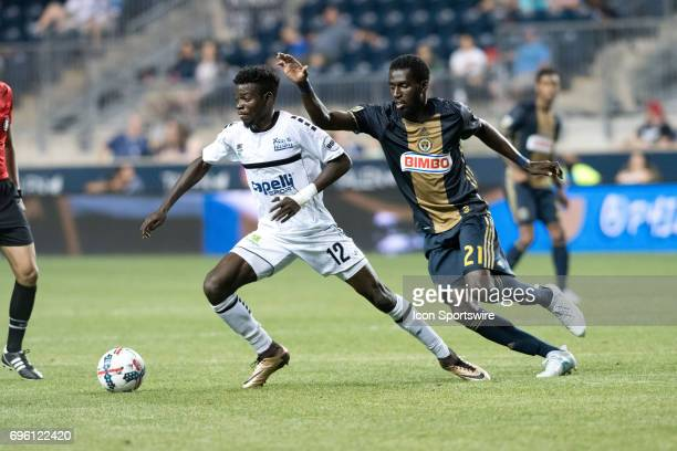 Islanders Midfielder Rasheed Olabiyi keeps the ball from Union Midfielder Derrick Jones in the second half during the US Open Cup Game between the...