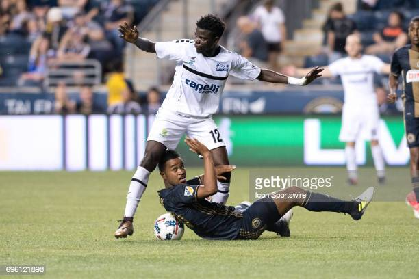 Islanders Midfielder Rasheed Olabiyi stands over Union Midfielder Roland Alberg in the second half during the US Open Cup Game between the Harrisburg...