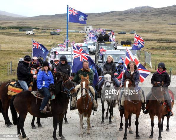 Islanders take part in the 'Proud to be British' parade along Ross Road in Port Stanley Falkland Islands on March 10 2013 Falkland Islanders were to...