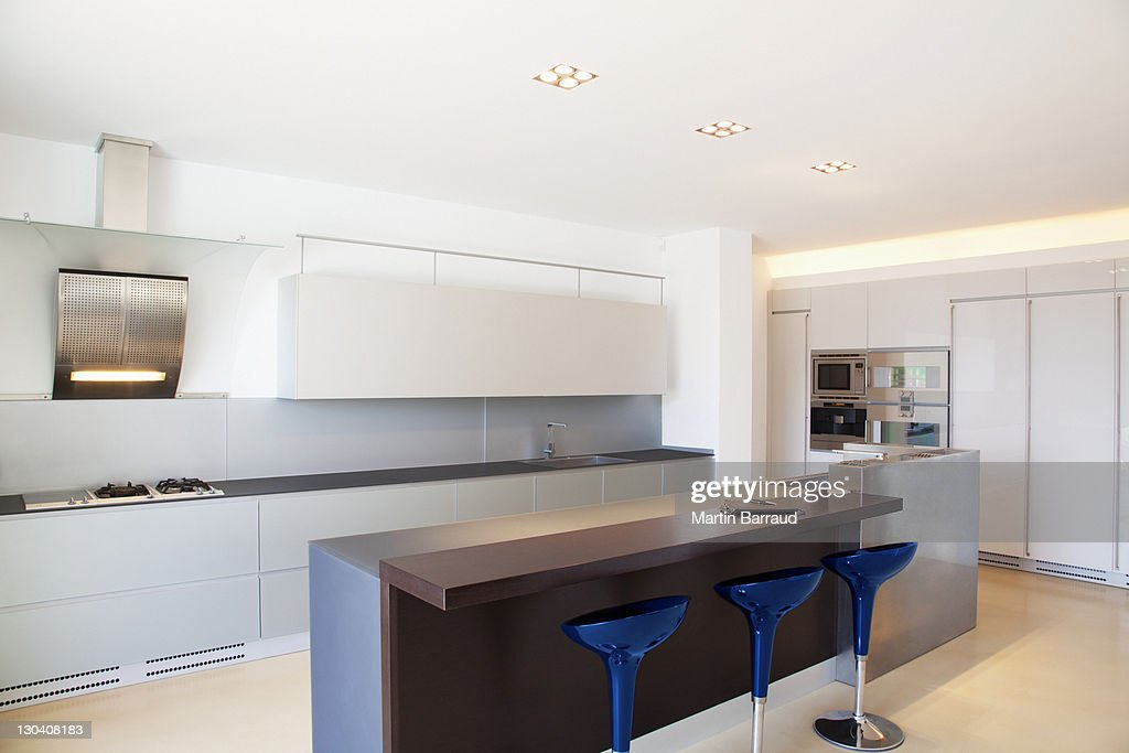 islands and stools in modern kitchen stock photo getty
