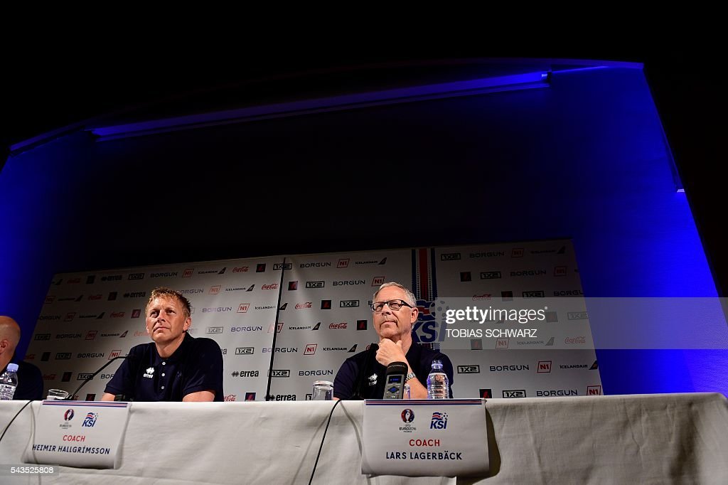 Island's coaches Heimir Hallgrimsson (L) and Lars Lagerbaeck give a press conference, on June 29, 2016 in Annecy, four days ahead of the team's quarter final match against France as part of the Euro 2016 European football championship. / AFP / TOBIAS