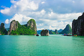 Rock islands in Halong Bay, Vietnam, Southeast Asia. UNESCO World Heritage Site.