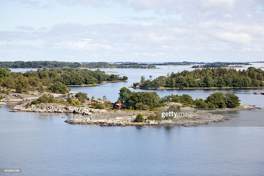 Islets in Stockholm outer Archipelago with small house.