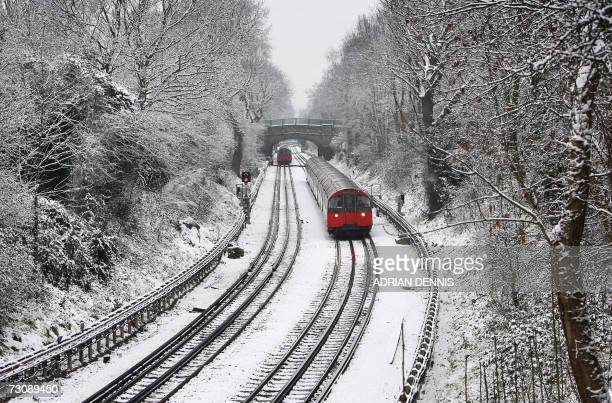 A Piccadilly line underground train crawls along the snowcovered tracks as it approaches Osterley Station west of London 24 January 2007 One to two...
