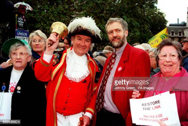 Islington's Labour MP Jeremy Corbyn with London's town crier sixty four year old Peter Moore outside parliament in London with other pensioners...