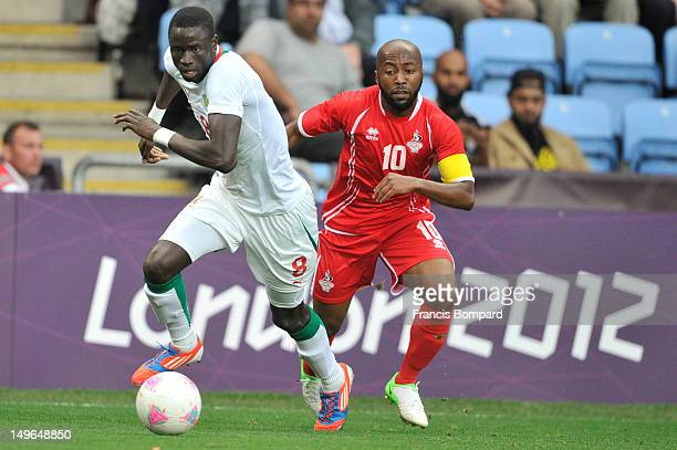 Ismaeil Matar of United Arab Emirates fighting for the ball against Kara Mbodj of Senegal during the Men's Football first round Group A Match between...