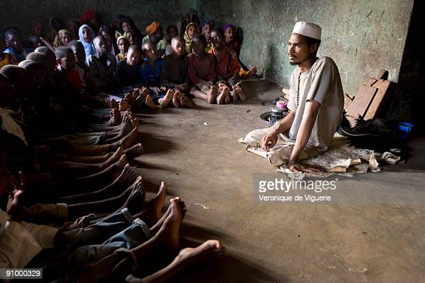 Ismael a religious teacher with his Koranic students in a madrasa in Korogho Ivory Coast He is disabled and is only able to survive thanks to the...