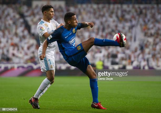 Ismael Athuman of Fuenlabrada clears the ball from Achraf Hakimi of Real Madrid CF during the Copa del Rey Round of 32 Second Leg match between Real...