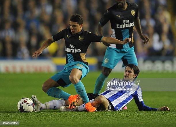 Ismael Bennacer of Arsenal challenged by Sam Hutchinson of Sheff Wed during the Capital One Cup Fourth Round match between Sheffield Wednesday and...