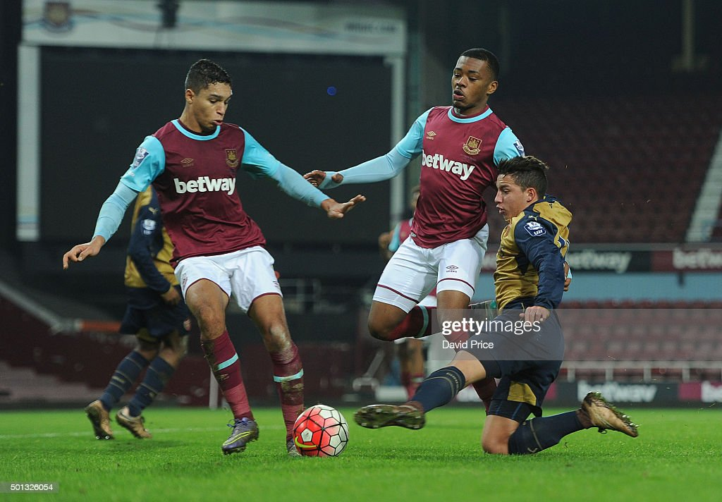 Ismael Bennacer of Arsenal challenges Kyle Knoyle as Amos Nasha of West Ham closes in during match between West Ham United U21 and Arsenal U21 at Boleyn Ground on December 14, 2015 in London, England.