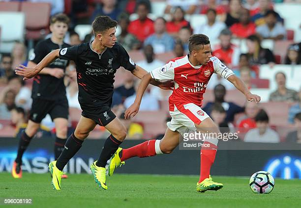 Ismael Bennacer of Arsenal is challenged by Cameron Brannagan of Liverpool during the match between Arsenal U23 and Liverpool U23 at Emirates Stadium...