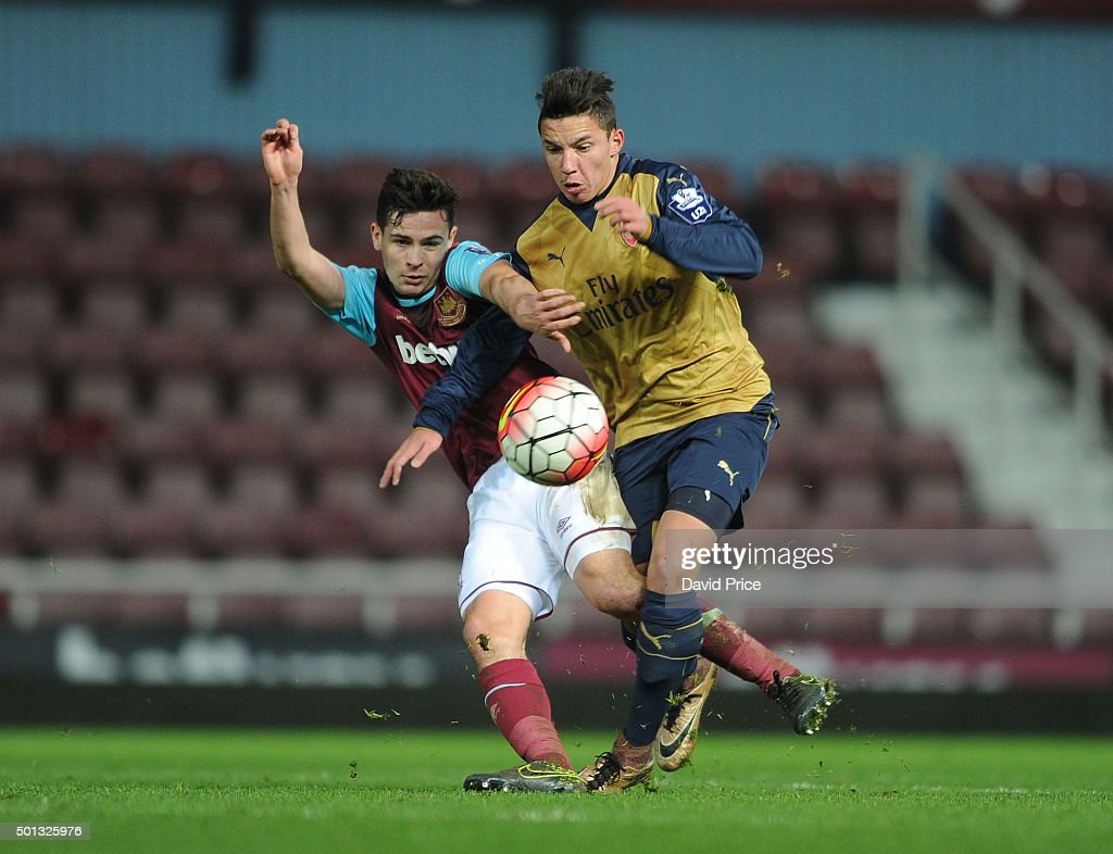 Ismael Bennacer of Arsenal is tackled by Josh Cullen of West Ham during match between West Ham United U21 and Arsenal U21 at Boleyn Ground on December 14, 2015 in London, England.