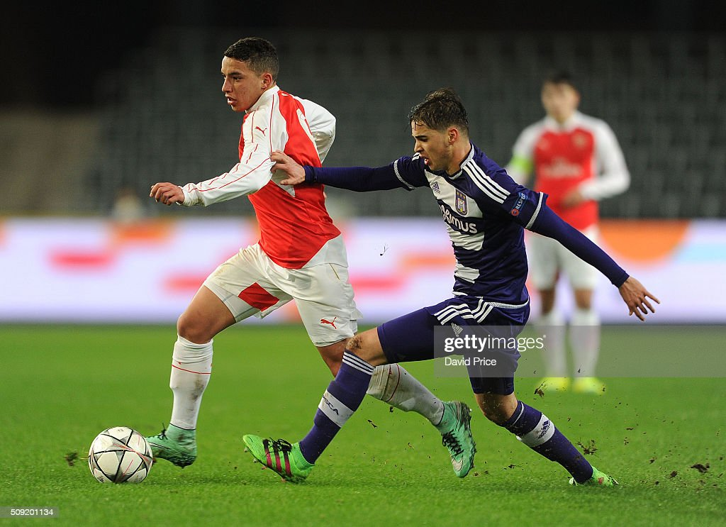 Ismael Bennacer of Arsenal takes on Samy Bourard of Anderlecht during the match between Anderlecht and Arsenal at Constant Vanden Stock Stadium on February 9, 2016 in Brussels, Bruxelles-Capitale, Region de.
