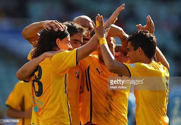 Ismael Blanco of AEK Athens celebrates with his team mates after scoring his team's second goal during the preseason friendly match between Sydney FC...