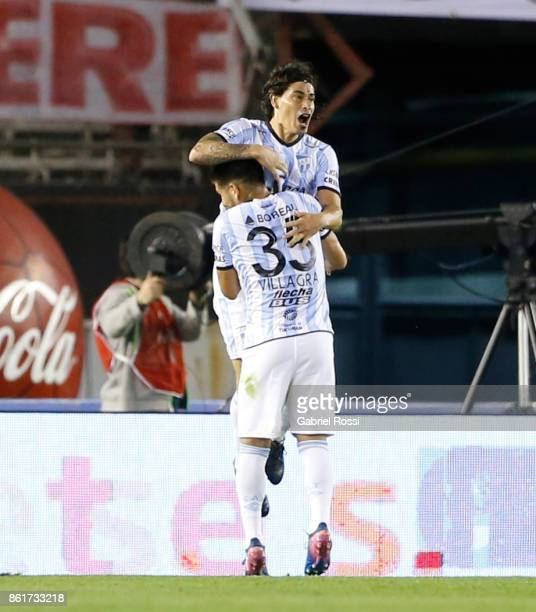 Ismael Blanco of Atletico de Tucuman celebrates with teammate Cristian Villagra after scoring the second goal of his team during a match between...