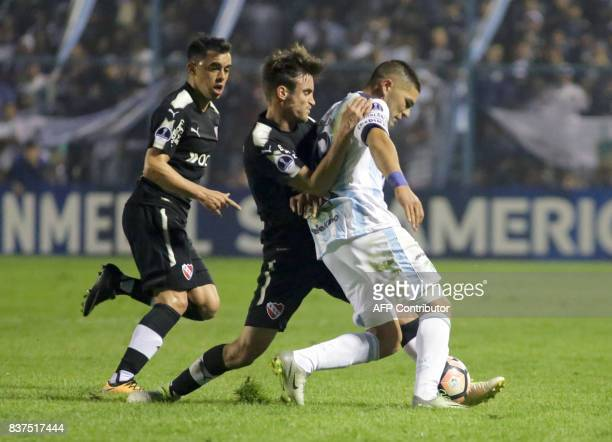 Ismael Blanco of Atletico Tucuman disputes the ball with Nicolas Tagliafico of Independiente in their Copa Sudamericana 2017 match in the Jose Fierro...