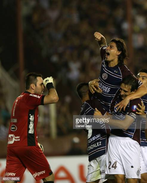 Ismael Blanco of Lanus celebrates with teammates after scoring during a match between Lanus and Ponte Preta as part of the Copa TOTAL Sudamericana at...