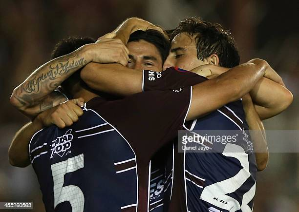 Ismael Blanco of Lanus partially covered by teammates celebrates after scoring during a match between Lanus and Ponte Preta as part of the Copa TOTAL...
