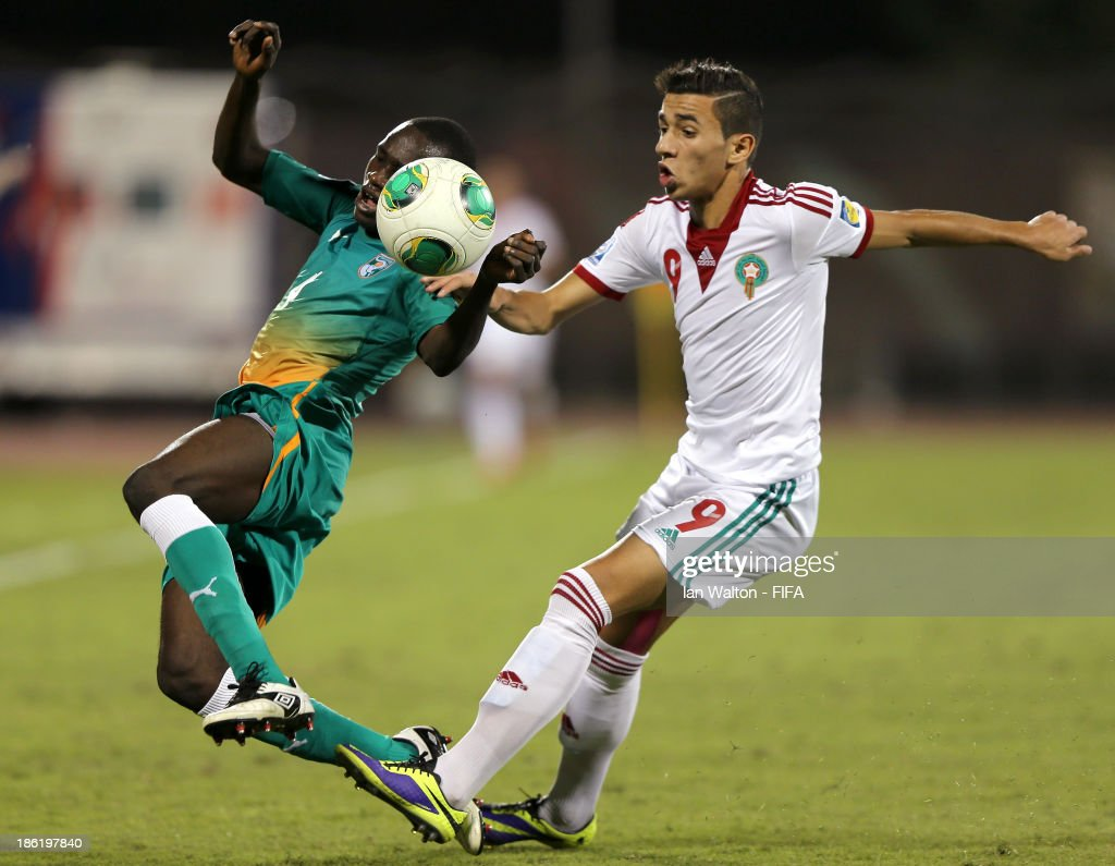 Ismael Diallp of Ivory Coast is tackled by Karim Achahbar of Morocco during the Round of 16 match of the FIFA U-17 World Cup between Morocco and Ivory Coast at Fujairah Stadium on October 29, 2013 in Fujairah, United Arab Emirates.