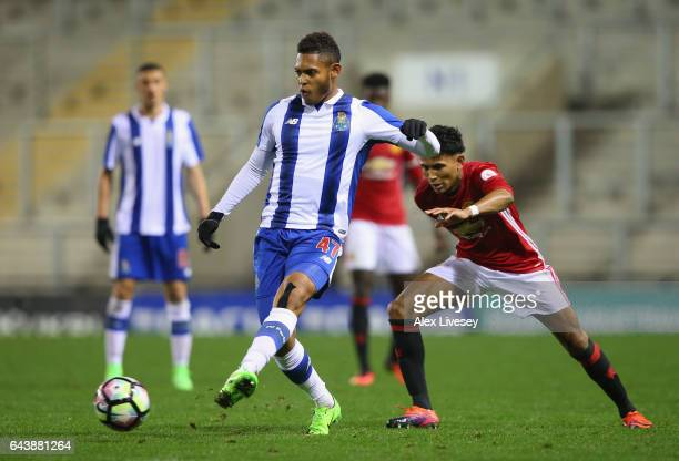 Ismael Diaz of Porto passes the ball under pressure from Demetri Mitchell of Manchester United during the Premier League International Cup Quarter...