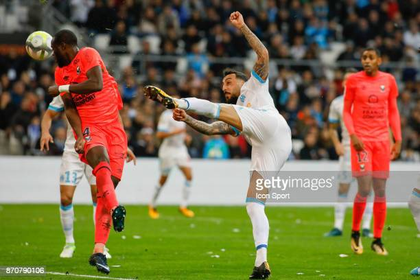 Ismael Diomande of Caen and Konstantinos Mitroglou of Marseille during the Ligue 1 match between Olympique Marseille and SM Caen at Stade Velodrome...