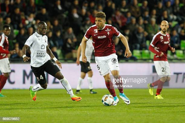 Ismael Diomande of Caen and Simon Falette of Metz during the Ligue 1 match between Fc Metz and SM Caen at Stade SaintSymphorien on April 15 2017 in...