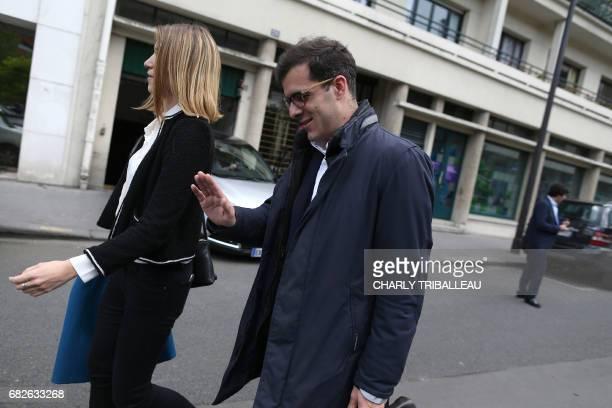 Ismael Emelien adviser at the party's La Republique en marche gestures at the entrance of the Quai Branly museum during an information day for La...