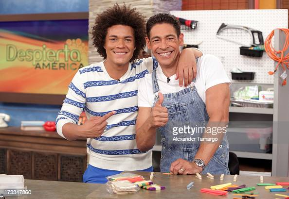 Ismael 'Mando' Cruz Cordoba and Johnny Lozada are seen during Sesame Street's visit of Univision's 'Despierta America' at Univision Headquarters on...