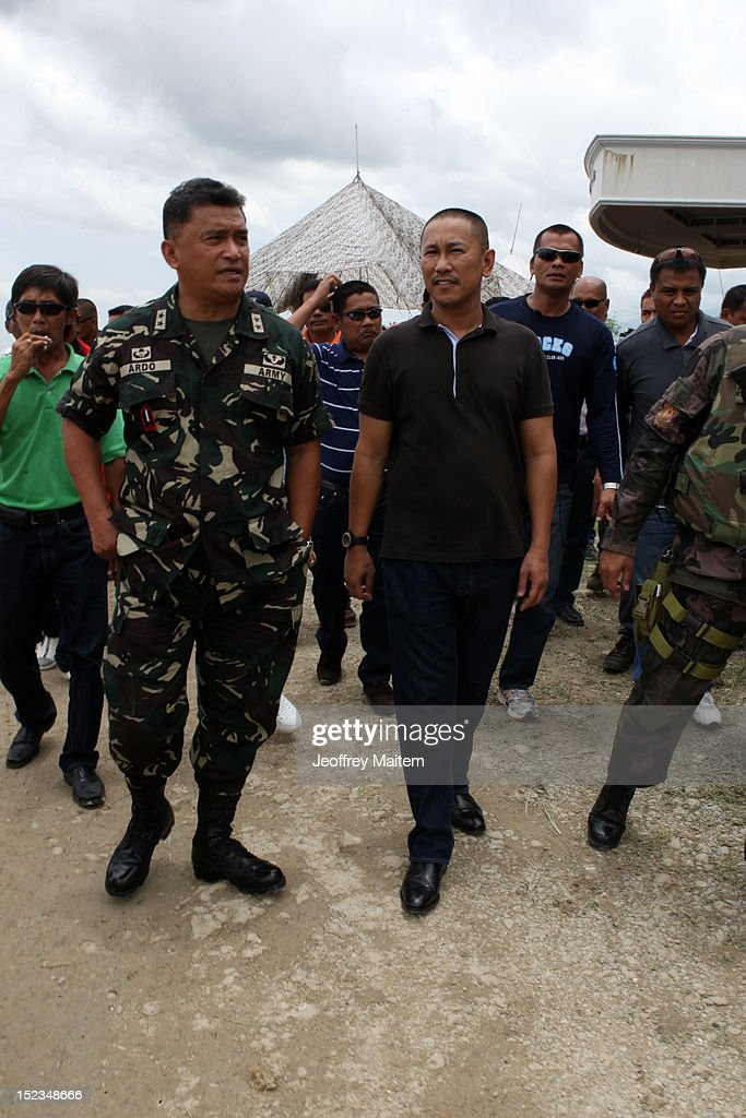 Ismael Mangudadatu, governor in the southern Philippine province of Maguindanao, is seen along with regional military commander Major General Rey Ardo during his first visit on September 19, 2012 in Datu Hoffer. The town is named after late Hoffer Ampatuan, one of the sons of Andal Ampatuan Sr. who was killed in shootout. Ampatuan Sr. is the alleged mastermind in the world's worst political mass murders on November 23, 2009 where Mangudadatu's wife, relatives and 30 journalists were massacred.