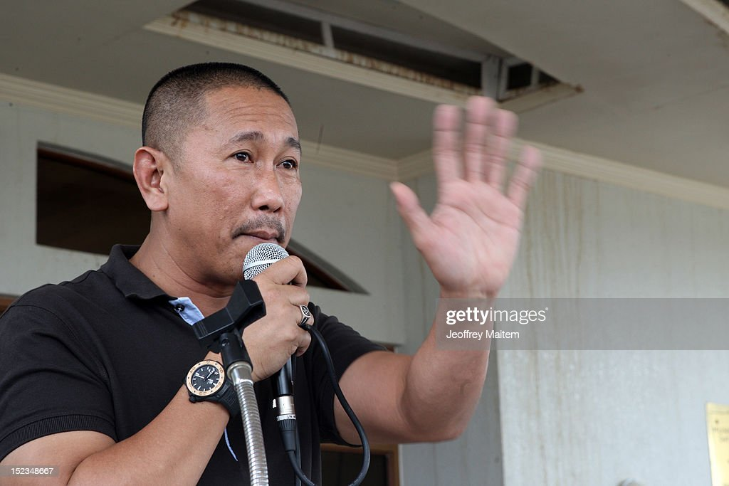 Ismael Mangudadatu, governor in the southern Philippine province of Maguindanao, gesture as he speaks to crowd during his first visit on September 19, 2012 in Datu Hoffer. The town is named after late Hoffer Ampatuan, one of the sons of Andal Ampatuan Sr. who was killed in shootout. Ampatuan Sr. is the alleged mastermind in the world's worst political mass murders on November 23, 2009 where Mangudadatu's wife, relatives and 30 journalists were massacred.