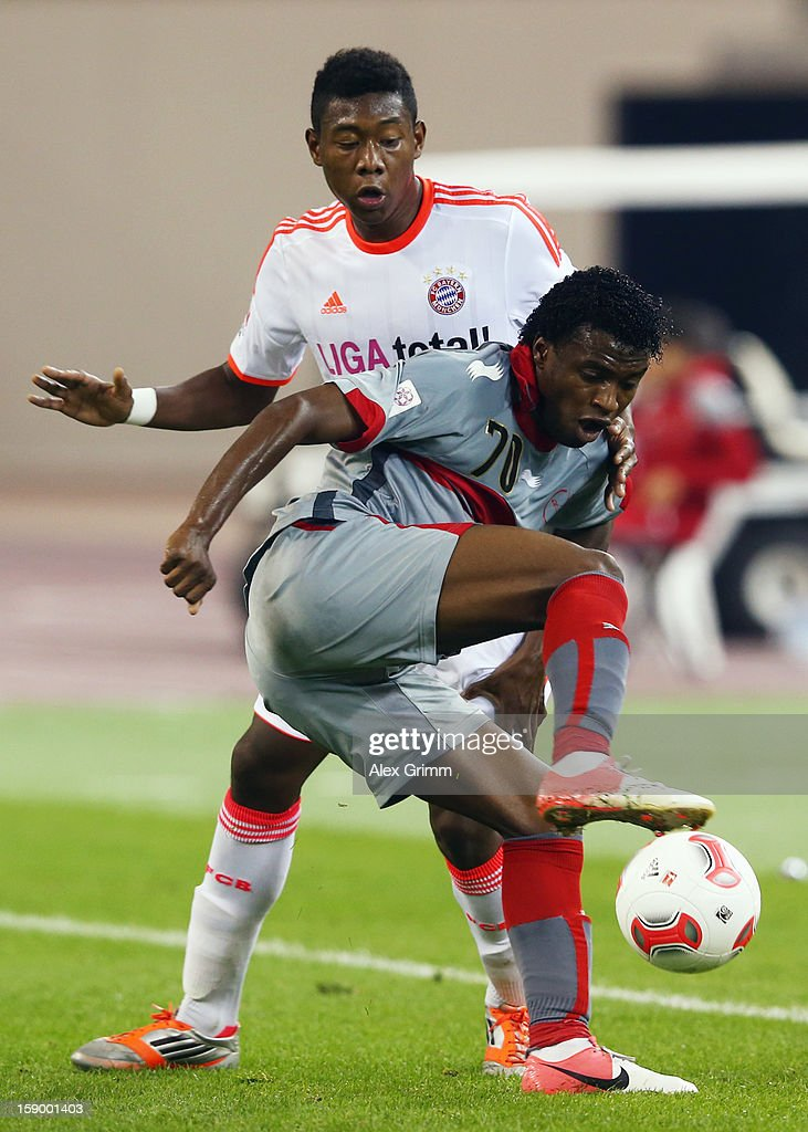 Ismael of Lekhwiya is challenged by <a gi-track='captionPersonalityLinkClicked' href=/galleries/search?phrase=David+Alaba&family=editorial&specificpeople=5494608 ng-click='$event.stopPropagation()'>David Alaba</a> of Muenchen during the international friendly match between Lekhwiya Sports Club and FC Bayern Muenchen at Khalifa International Stadium on January 5, 2013 in Doha, Qatar.