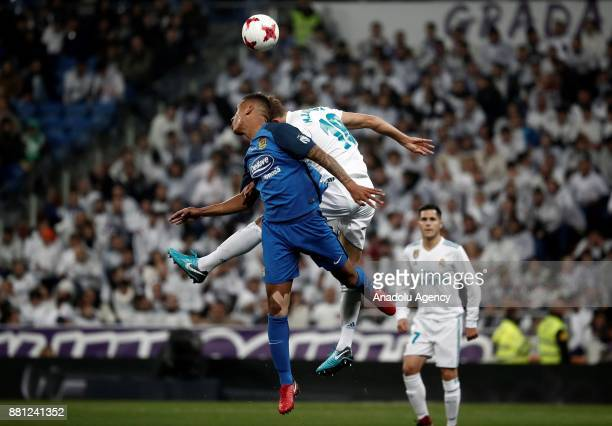 Ismael Said Athuman Gonzalez of Fuenlabrada in action against Marcos Llorente of Real Madrid during King's Cup soccer match between Real Madrid and...