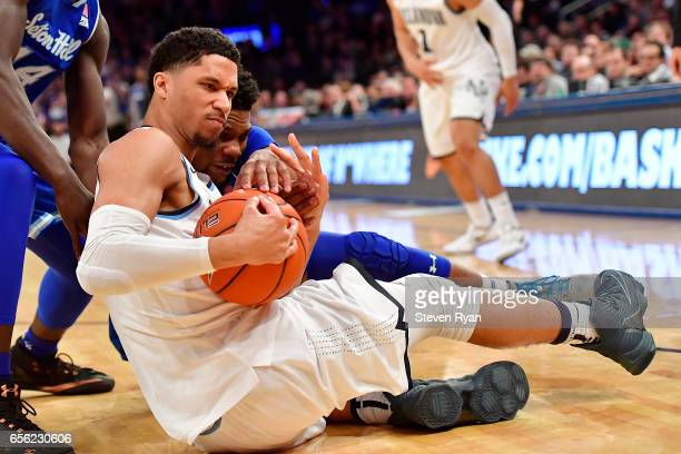 Ismael Sanogo of the Seton Hall Pirates and Josh Hart of the Villanova Wildcats battle for a loose ball during the Big East Basketball Tournament...