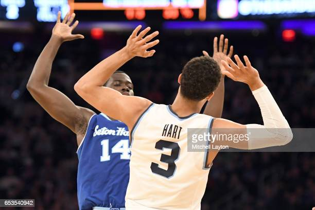 Ismael Sanogo of the Seton Hall Pirates and Josh Hart of the Villanova Wildcats bump into each other during the Big East Basketball Tournament...