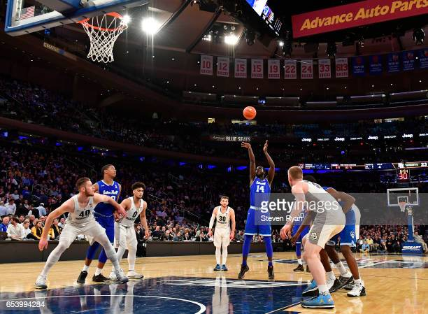Ismael Sanogo of the Seton Hall Pirates attempts a free throw against the Marquette Golden Eagles during the Big East Tournament Quarterfinals at...