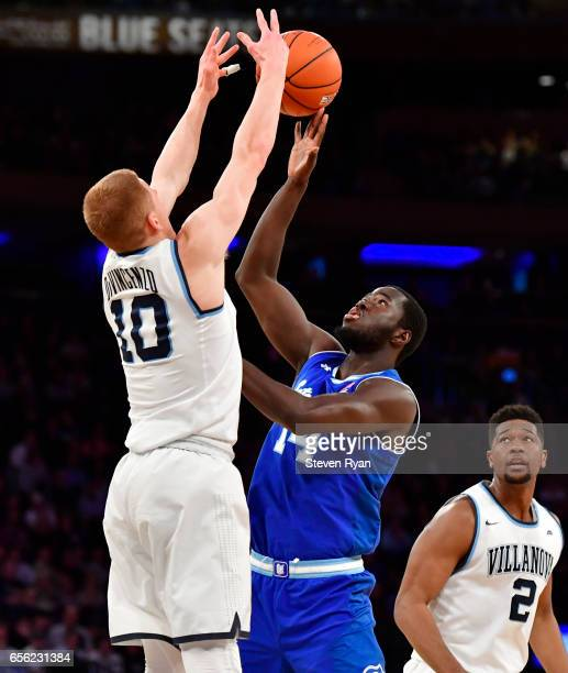 Ismael Sanogo of the Seton Hall Pirates is defended by Donte DiVincenzo of the Villanova Wildcats during the Big East Basketball Tournament...