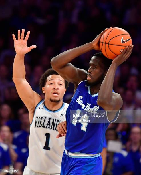 Ismael Sanogo of the Seton Hall Pirates is defended by Jalen Brunson of the Villanova Wildcats during the Big East Basketball Tournament Semifinals...