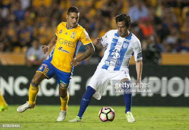 Ismael Sosa of Mexico's Tigres vies for the ball withJonathan Urretaviscaya of Mexicos Pachuca during the first leg of final of the CONCACAF...