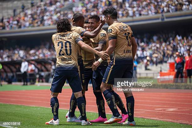 Ismael Sosa of Pumas celebrates with his teammates after scoring the first goal of his team during a 6th round match between Pumas UNAM and Dorados...