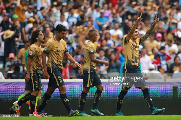 Ismael Sosa of Pumas celebrates with his teammates after scoring the first goal of his team during a 10th round match between Pumas UNAM and Tigres...