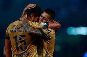 Ismael Sosa of Pumas celebrates with teammate Eduardo Herrera after scoring the second goal of his team during the match between Pumas UNAM and...
